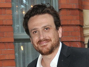 Jason Segel departs the Dylan hotel in the rain while wearing a suit Dublin, Ireland