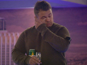 Big Brother 2012 Day 8: Chris keeps his beer close to his chest.