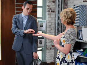 Michael is stunned as Jean presents his St. Christopher charm.