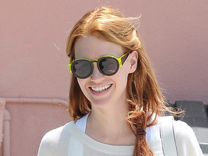 January Jones, sporting a new red hair color,  is seen leaving pilates class in Los Feliz Los Angeles, California