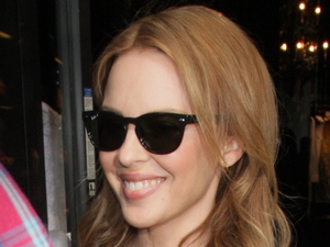 Kylie Minogue exits Dolce & Gabbana on Rodeo Drive in Beverly Hills. Los Angeles, California