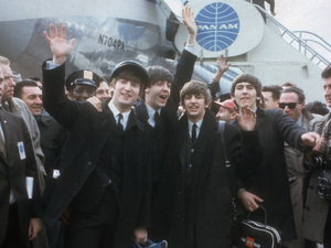 The Beatles arrive at New York&#39;s Kennedy Airport Feb. 7, 1964 for their first U.S. appearance