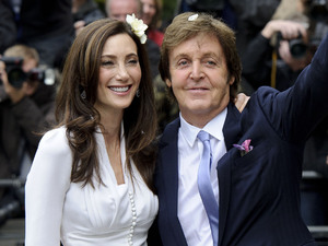 Paul McCartney and American heiress Nancy Shevell greet fans after their wedding at Marylebone Town Hall, London