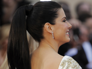 Sandra Bullock arrives before the 84th Academy Awards 