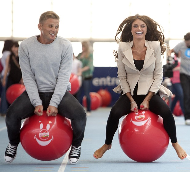 Jeff Brazier and Chloe Sims on Babybel spacehoppers for Barnado's