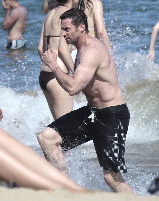 Hugh Jackman on holiday at the beach with family Barcelona, Spain