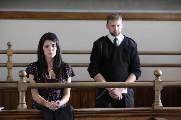 A tearful Alicia stands in the dock at her trial