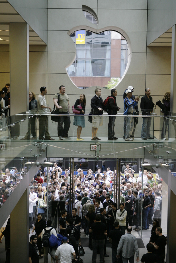 Customers rush into the Apple Store