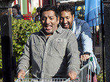 Masood rolls down the pavement in the trolley.