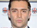 Amy Winehouse's former boyfriend Reg Traviss is charged with two counts of rape.