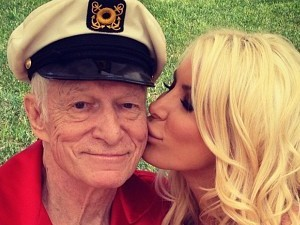 Hugh Hefner and Crystal Harris kiss on Independence Day