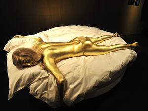 Jill Masterson's golden body from 'Goldfinger', 1964 Designing 007 - Fifty Years of Bond Style - press view held at the Barbican Centre. London