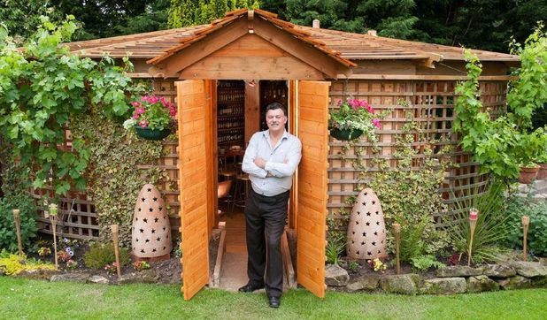 John Plumridge outside his winning 'Woodhenge' pub shed in Shrewsbury, Shropshire