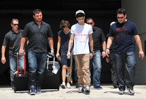 Harry Styles and Zayne Malik of One Direction leaving their hotel in Ft Lauderdale for the final night of their 2012 American Tour Ft Lauderdale