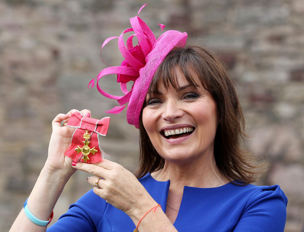 Lorraine Kelly collects her OBE at the Palace of Holyrood in Edinburgh