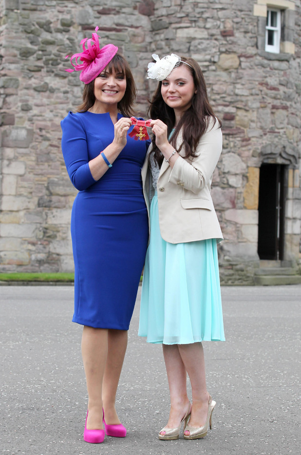 Lorraine Kelly, with daughter Rosie, collects her OBE at the Palace of Holyrood in Edinburgh