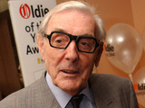 Eric Sykes celebrates his 'Oldie of the Year' award in the annual senior citizens' award ceremony at Simpson's in the Strand, London in 2002