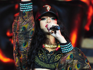Rihanna on stage at Wireless Festival. Singer has confirmed she will design a collection for River Island.