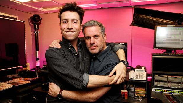 Nick Grimshaw hugs Chris Moyles