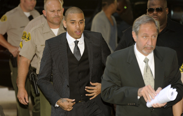 Chris Brown, center, and attorney Mark Geragos, right, arrive for Brown's sentencing for assaulting his girlfriend Rihanna, at Los Angeles County Superior Court in Los Angeles, Tuesday, Aug. 25, 2009