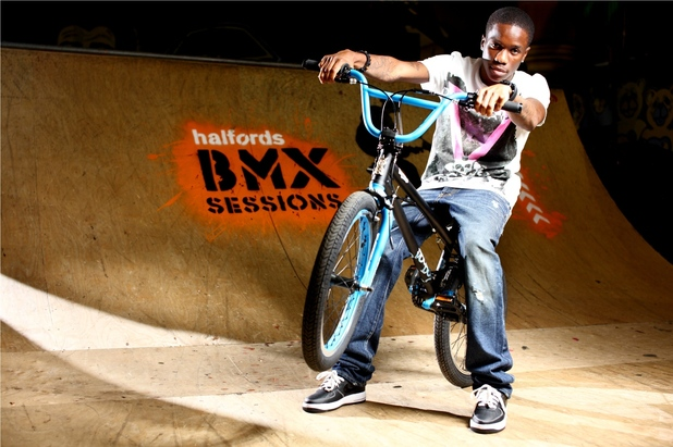 Tinchy Stryder riding a BMX