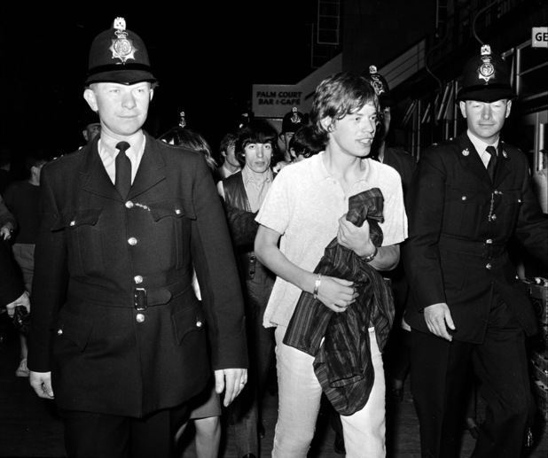 Mick gets a police escort