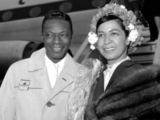 Nat 'King Cole and his wife, Maria Cole (nee Hawkins Ellington) arriving at London Airport, United Kingdom, on May 12, 1960 from New York. Nat is here for the royal command variety show and two appearances at the new Victoria Theatre as part of a European tour.