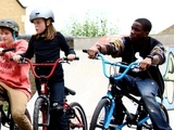 Tinchy Stryder rides a BMX bike
