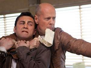 Still of Bruce Willis and Joseph Gordon Levitt in the movie &#39;Looper&#39;