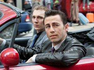Still of Joseph Gordon Levitt and Paul Dano in the movie &#39;Looper&#39;