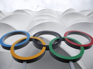 The Olympic rings are displayed outside the basketball arena in the Olympic Park before the start of the 2012 Summer Olympics