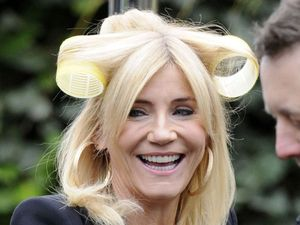 Michelle Collins on set with hair rollers