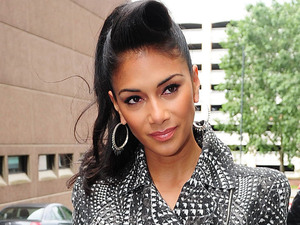 'X Factor' judge Nicole Scherzinger is pictured leaving her hotel to attend the boot camp stage of the competition in Liverpool
