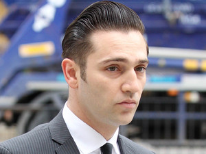 Amy Winehouse's former boyfriend Reg Traviss appears at Westminster Magistrates' Court where he is charged with two counts of rape