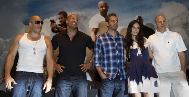 Actors from the film Fast Five, from left to right, Vin Diesel, Dwayne Johnson, Paul Walker, Jordana Brewster and producer Neal Moritz, pose for a photo after a press conference promoting their movie in Rio de Janeiro, Brazil, Wednesday April 13, 2011