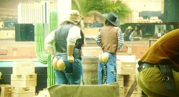 Housemates flash their bums