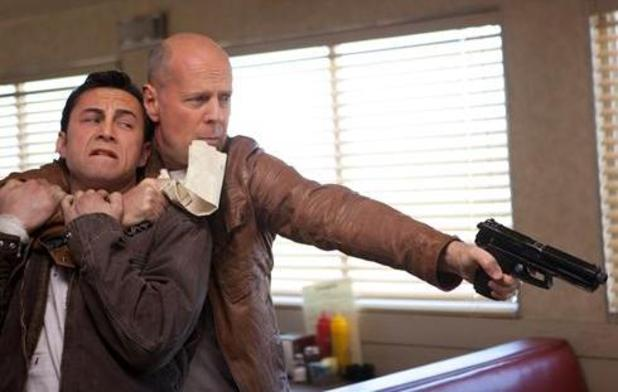Still of Bruce Willis and Joseph Gordon Levitt in the movie 'Looper'