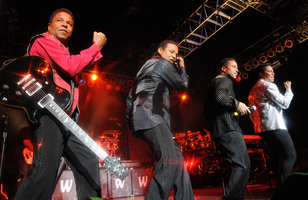 Tito Jackson, Jackie Jackson, Marlon Jackson, and Jermaine Jackson on stage for The Jacksons Unity Tour 2012.