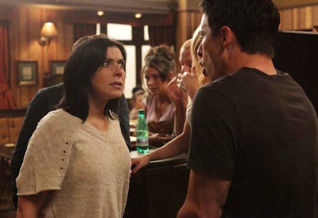In the middle of the crowded pub Michelle scolds Ryan for taking drugs