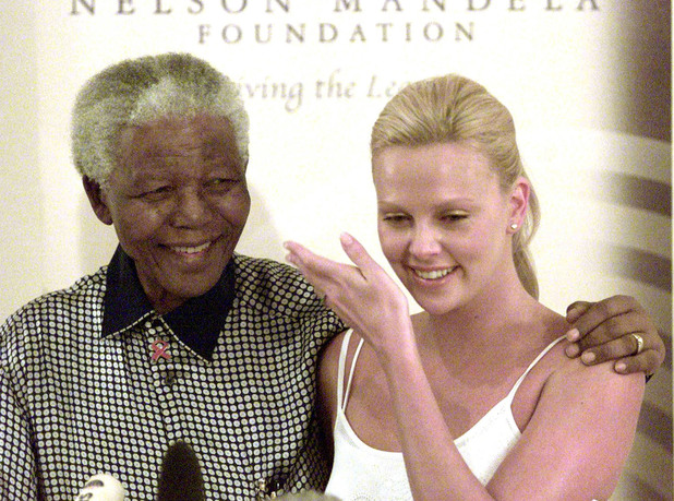 Nelson Mandela meets South African-born actress Charlize Theron in Johannesburg, 2004. Mandela is said to have hailed Theron for her hard work and success in Hollywood
