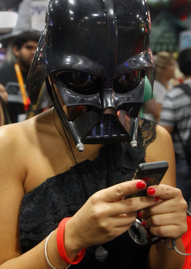 Fan wears a Darth Vader mask