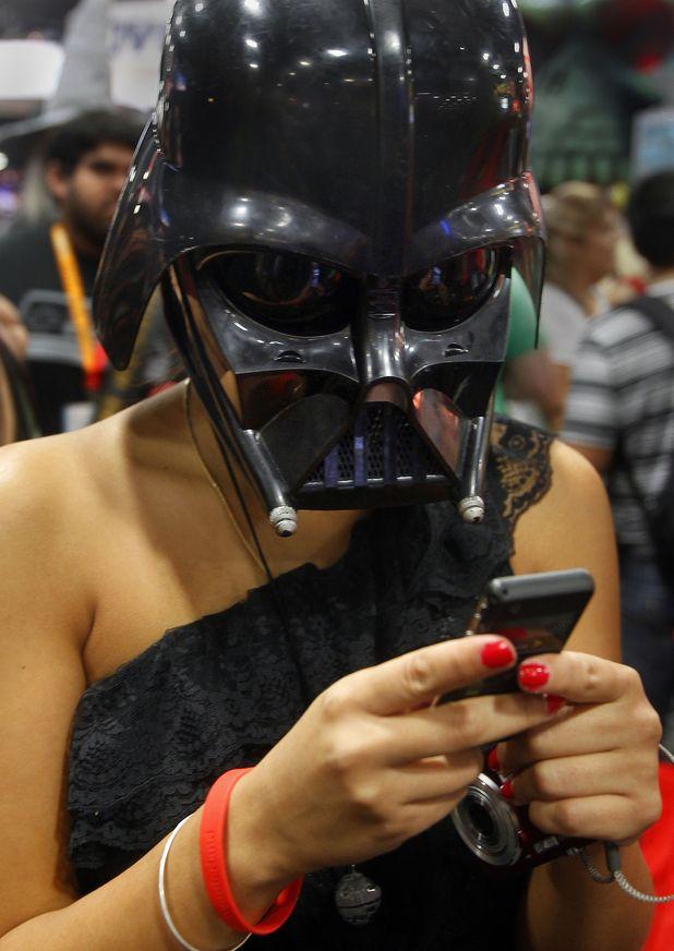 Fan wears a Darth Vader mask