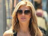 'The Real Housewives of Orange County' star Alexis Bellino wears a 'Team Alexis' top while out shopping with a friend in Los Angeles