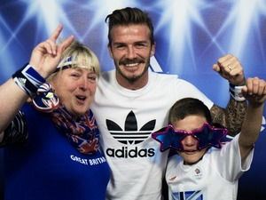 David Beckham poses with young fan at Westfield Stratford in London.