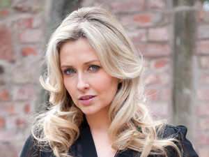 Gemma Merna as Carmel McQueen on Hollyoaks