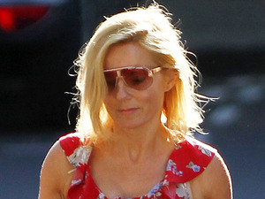 Geri Halliwell gets into the summer spirit by wearing a floral dress while out and about in North London