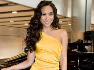 Singer and TV presenter Myleene Klass performs 'Chariots of Fire' to incoming passangers at Terminal 5, Heathrow Airport