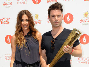 Presenters Dave Berry and Lisa Snowdon backstage at the Coca Cola London 2012 Olympic Torch Relay concert, in Hyde Park, central London.