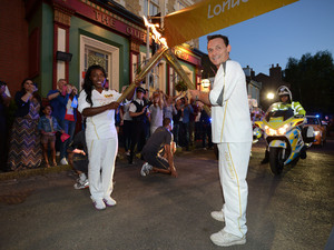 Billy Mitchell (Perry Fenwick) carrying the Olympic Torch on 23rd July 2012
