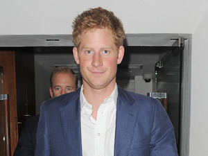Prince Harry is all smiles, as he leaves The Salon nightclub in Mayfair at 4.10am, flanked by security.